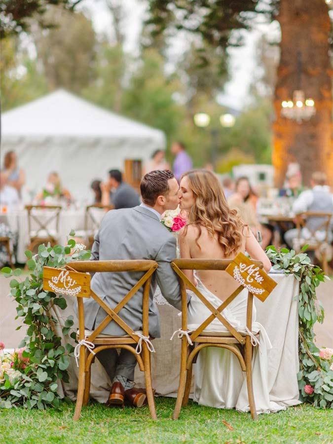 Outdoor_Wedding_Rustic_Mr_Mrs_Chair_Market_Lights_Vintage_Bohemian__Camarillo_Ranch_Southern_California_Venue_Kiss